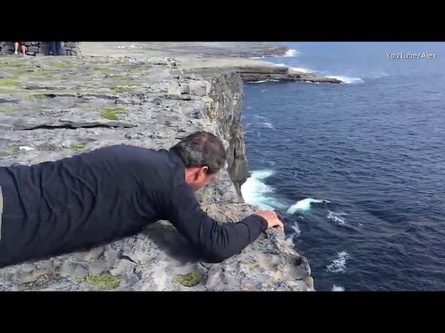 Dad overcomes crippling fear of heights to peek at Atlantic ocean