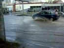 Прошел ливень в Лененском районе. Не пройти не проехать даже трамвайных путей не видно.