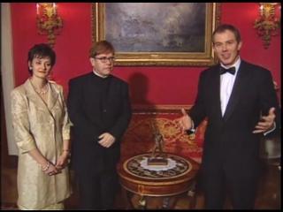 Elton John wins the Freddie Mercury Award presented by Tony Blair. BRIT Awards 1998