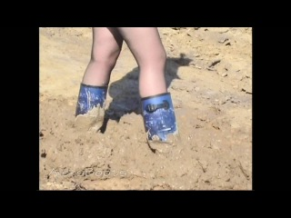 The girl Christina plays with her rubber boots in the mud.Part-2(11/09/16)