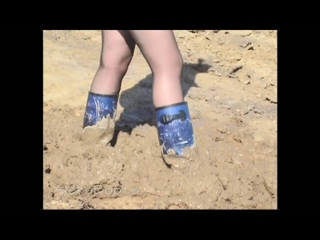 The girl Christina plays with her rubber boots in the 09 16
