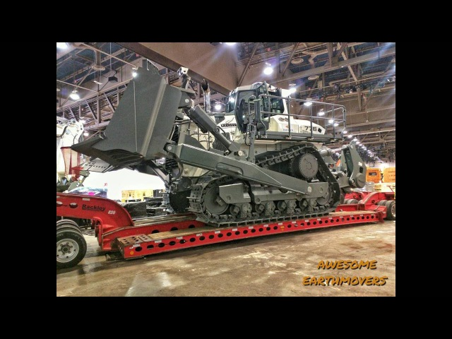 Loading and moving the Worlds largest hydrostatic bulldozer, the Liebherr PR776