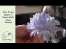 Wafer paper flowers and steam to manipulate them for cake decorating.