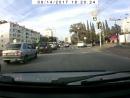 Налево через две полосы на красный, чуть не сбив пешеходов.
