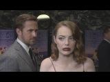 La La Land gala Ryan Gosling creeps up on Emma Stone!
