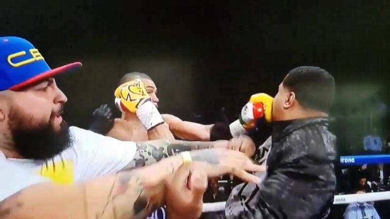 Boxer's Uncle Sneaks in Punch Andre Dirrell vs. Jose Uzcategui disqualified