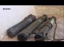 Боец СДС показывает турецкое оружие, захваченное у ИГИЛ