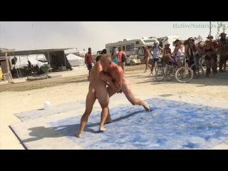 naked oil wrestling at Burning Man 2016