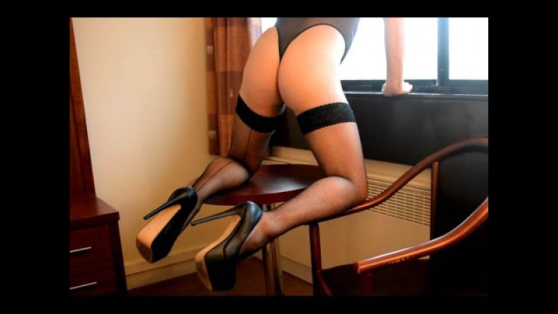 Sexy crossdresser in heels and stockings wiggling at the hotel