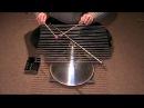 Instrument à percussion: Tiges d'acier et lampe industrielle