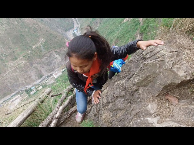 The Most Dangerous Journey to School in the World ...Little Kids Climbing a 2,624 Foot Cliff