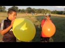 Group popping big balloons