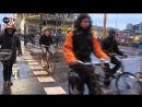 Cycling in the rain; morning rush hour in Utrecht (Netherlands)