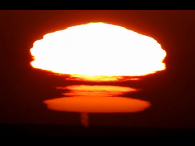Rare and unusual (The Novaya Zemlya effect) sunset mirage with green flashes and whales spouts