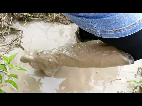 Girl in dirty leather boots and in a denim skirt in mud 2 VID 20170720 155649re