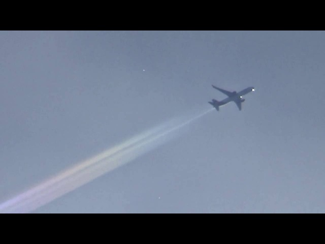 Chemtrail Plane Leaving A Rainbow Aerosol Trail--Stratospheric Aerosol Injection