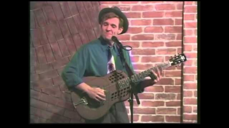 Catfish Keith in concert playing two song