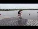 Guy Rides Skimboard Across Dock and Jumps Into Water - 987085-1