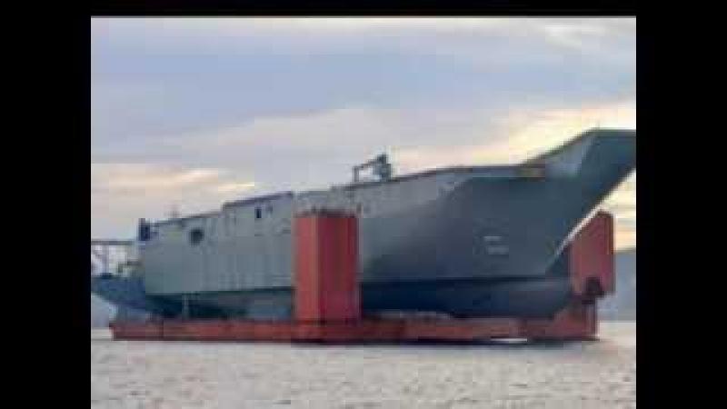 Blue Marlín con su apreciable carga del mega portaaviones LHD Adelaide