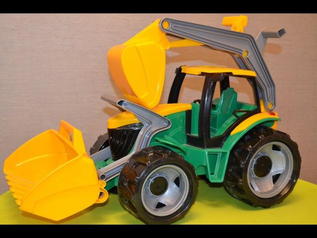 Распаковка игрушек. Трактор-экскаватор большой огромный с ковшом и отвалом