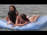 Rest of nudists in Odessa, naked girl floating on a mattress naked, showing her