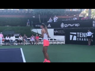 Warming up for her doubles match against serena williams