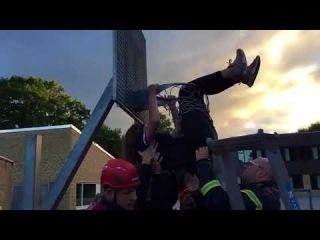 Team Rescues Girl Stuck in Basketball Hoop - 985194