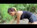 Nice cambodian girls catching fish in mud