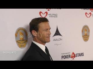 Брайан Краузе с сыном на благотворительном покерном турнире the Heroes for Heroes: Los Angeles Police Memorial Foundation Celebr