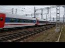 ЭП20-008 с высокоскоростным поездом Стриж проезжает станцию Фрязево Горьковского направления МЖД.