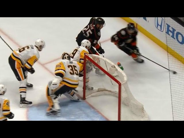 Penguins' Jarry gets stick tangled up with Guentzel to allow Henrique goal