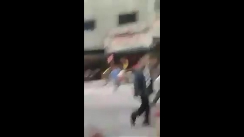 Video emerges showing the aftermath of a rocket attack which killed 35 civilians and wounded dozens in Jaramana Damascus