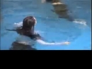 Wetlook - Two girls take a fully clothed swim in the pool