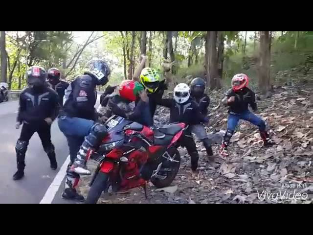 Crazy Bikers Dancing at Street and Traffic Light