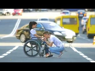 Carry Disabled Woman In The Wheelchair