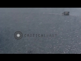 Strafing Japanese shore installations, ships and boats in Okinawa in Japan HD Stock Footage