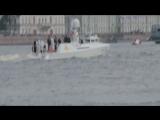 Владимир Владимирович Путин и Сергей Шойгу стоят на яхте и принимают парад на день ВМФ в Санкт-Петербурге. 30.07.2017.