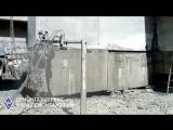 Резка толстой бетонной стены алмазным канатом.