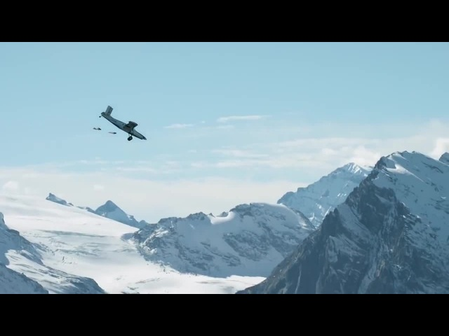 Like a boss | 2 wingsuit flyers BASE jump into a plane in mid-air. | A Door In The Sky