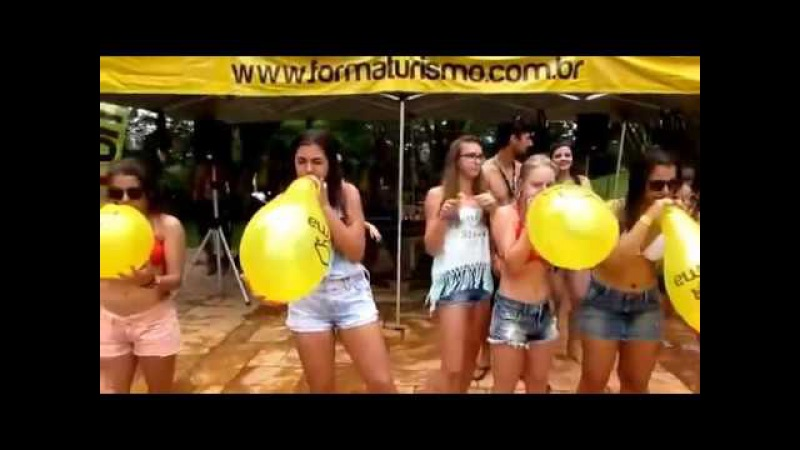 Balloon blow to pop race with a lot of girls