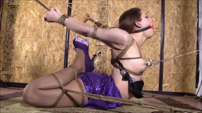 Brutal Hogtie in purple dress.