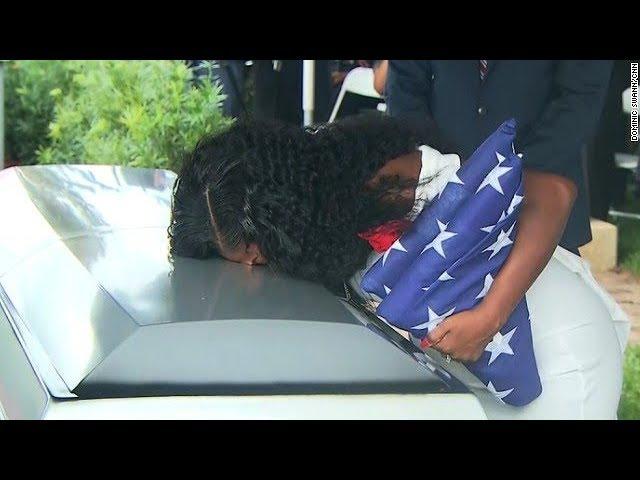 Fallen soldier's widow kisses casket at burial