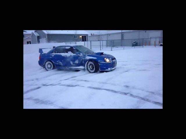 SNOW DRIFT BATTLE: Mitsubishi EVO vs Subaru WRX STI!