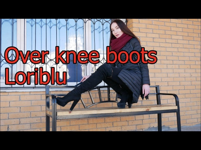 Christina in crazy over knee boots Loriblu with high heels walking in the street