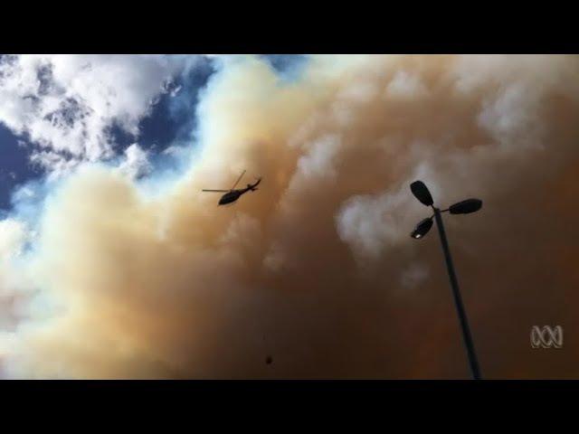 Bushfire on NSW south coast destroys up to 70 properties