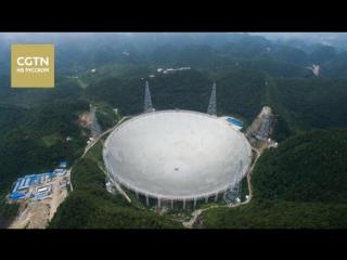 Чжань Шусинь охраняет радиотелескоп FAST в провинции Гуйчжоу