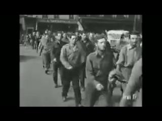 Американских пленных ведут по Парижу летом 1944. Французы в них плюют, пытаются ударить, кидают всякой хренью. Те самые французы