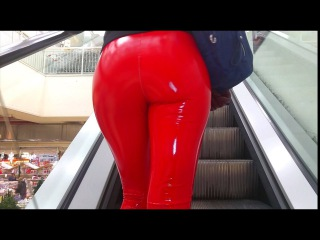 DANA LABO boots my passion - latex style - girl walking in public with hot red leggings