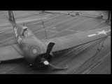 A US Navy F6F Hellcat fighter aircraft belly-lands on the deck of USS Essex under...HD Stock Footage