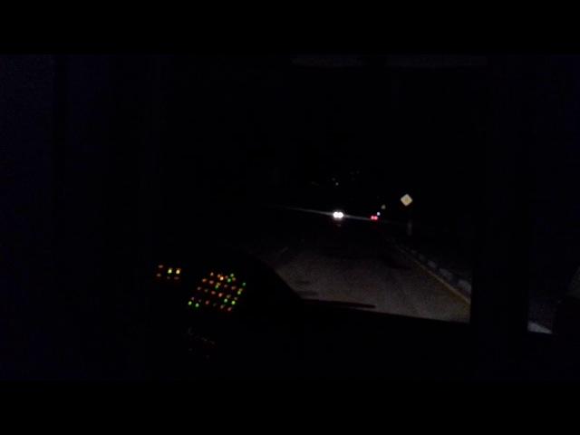 Троллейбус TROLZA едет среди ночи в Крымских горах